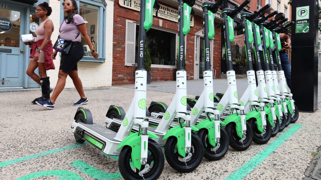Lime electric scooters on the sidewalk