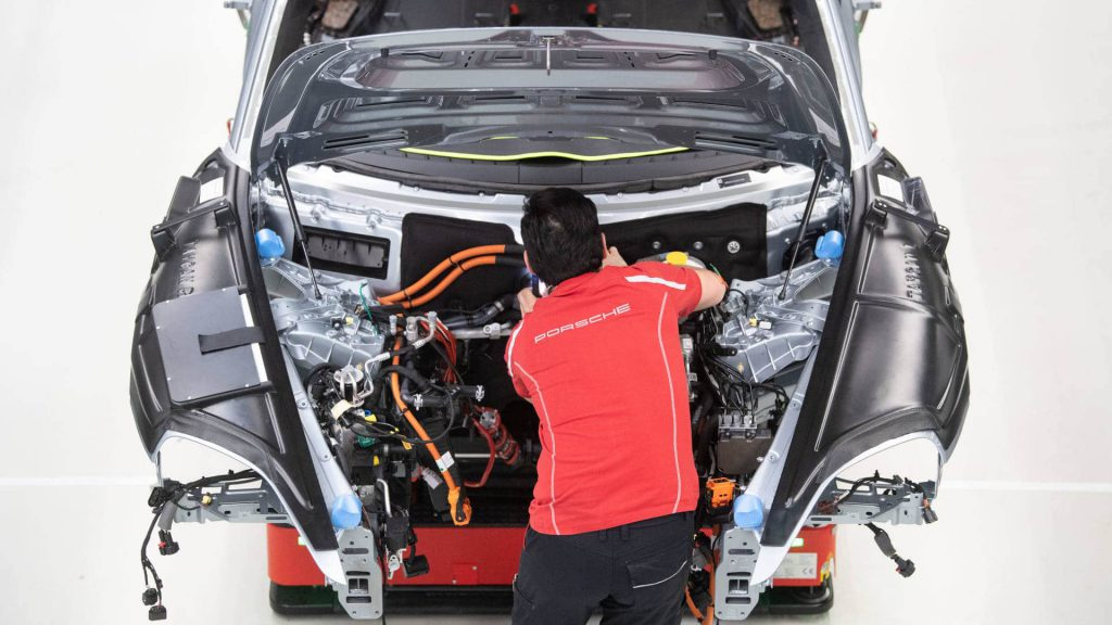 Porsche electric car being recycled by mechanic
