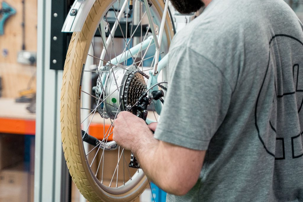 Man inspects electric bike post-production