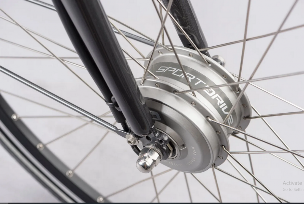 Close up shot of installed hub-drive motor on bicycle wheel